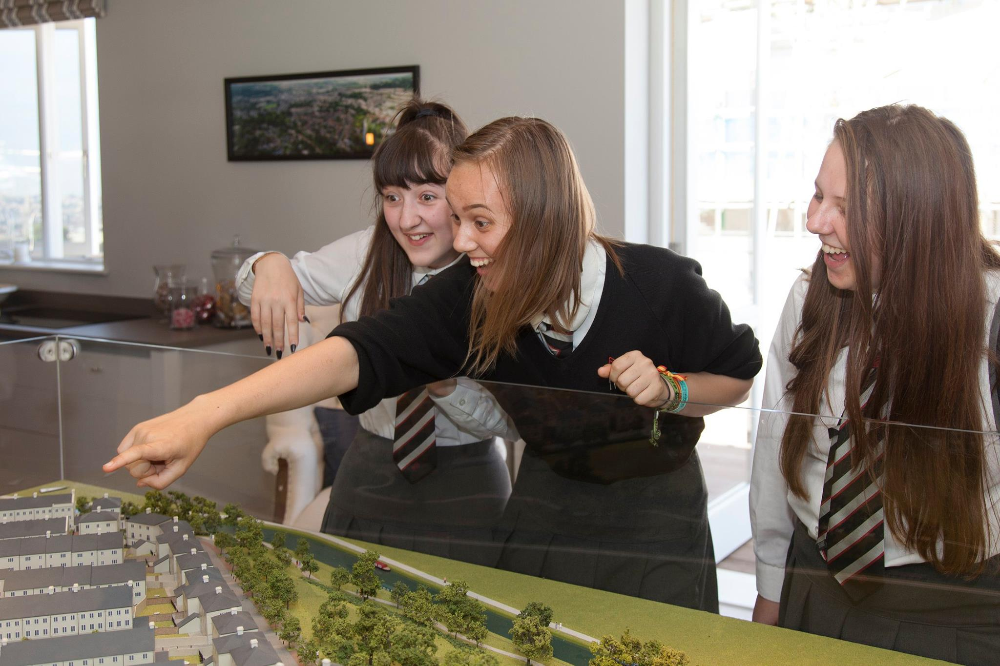 IKB looking at a scaled model of a housing development with Campbell Reith